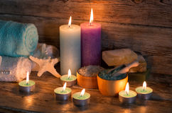 Items for spa. Towels and candles Royalty Free Stock Image