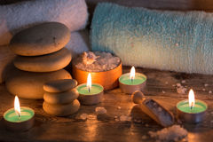Items for spa. Towels and candles Royalty Free Stock Images