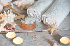 Items for spa. Towels and salt Royalty Free Stock Photography