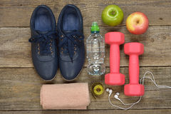 Items for sports. On a brown background, fitness concept Stock Photography