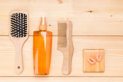 Items for styling hair on a light wooden background Stock Photography