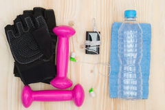 Items on the table for fitness classes. Pink dumbbells and stuff for sports Royalty Free Stock Photography