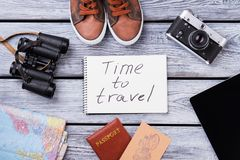 Items for traveling, top view. Items for traveling top view. Flat lay, wooden surface background royalty free stock photo