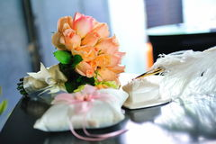 Items for wedding matrimony. Bouquet of roses, ring cushion and pen for wedding matrimony Royalty Free Stock Image