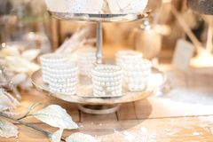 Items of winter wedding table. Winter wedding details on a wooden table Royalty Free Stock Photography