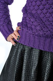 Items of women's clothing. Knit sweater and leather skirt Royalty Free Stock Photos