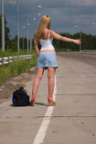 Itenerant attractive woman. Itenerant attractive woman on road Royalty Free Stock Image