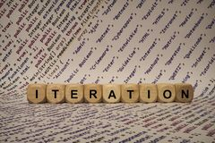 Iteration - cube with letters and words from the computer, software, internet categories, wooden cubes Stock Image