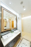 Iterior of a modern bathroom. With basin and mirror  at a new house Royalty Free Stock Photography