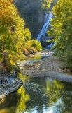 Ithaca Falls and Fall Creek. A fisherman in Fall Creek below Ithaca Falls in Ithaca, New York Stock Photos