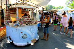 An itinerant blue car-shaped stall for selling handicraft in the Hippy Market of Ibiza Island in Spain stock photography