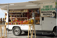Itinerant van selling olive oil and preserved food Royalty Free Stock Photo