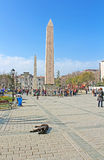 ITourists near Obelisk at hippodrome in Istanbul, Turkey royalty free stock image
