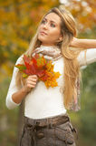 Its Autumn!. 20-25 years old beautiful sexy woman portrait holding leafs in natural autumn outdoors Stock Photos