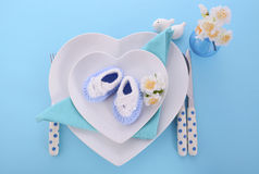 Its a Boy baby shower table place setting. Its a Boy blue theme baby shower table place setting with heart shape plates on blue table background stock photography