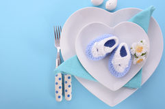 Its a Boy baby shower table place setting. Its a Boy blue theme baby shower table place setting with heart shape plates on blue table background royalty free stock photography