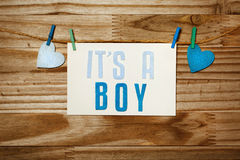 ITS A BOY card hanging with clothespins Stock Image
