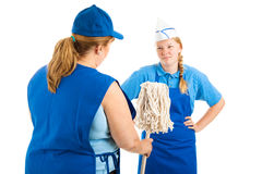 Its a Dirty Job. But somebody's got to do it.  Boss hands teen worker a mop to clean up a mess.  Isolated on white Stock Image