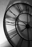 Its almost eight and VERY late... High contrast with long shadows on a large clock, projecting a feeling of hating work at Eight A.M royalty free stock photo