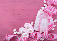 Its a Girl Baby Shower or Nursery background. With baby clothes and accessories with copy space for your text here Stock Photo