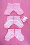 Its a Girl Baby Shower or Nursery concept with socks on pink woo Stock Photography