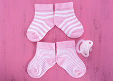 Its a Girl Baby Shower or Nursery concept with socks on pink woo Royalty Free Stock Images