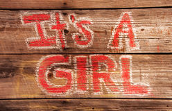 Its a Girl Birth Announcement Painted on a Wooden Wall Stock Photo