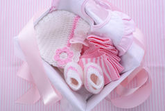 Its a Girl pink theme baby shower gift box. With baby clothes, bib, bonnet, booties, pacifier and socks Stock Images