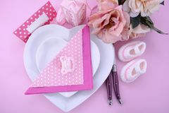 Its a Girl pink theme baby shower table setting. With heart shape plates on pink table background Royalty Free Stock Photo