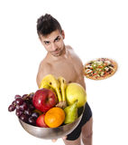 Choose this healthy way. Its a healthy advice eat fruit. Isolated fitness man offers a healthy diet Stock Photography