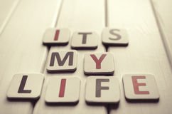 Its My Life. Words composed of letters on a background of wood Stock Photo