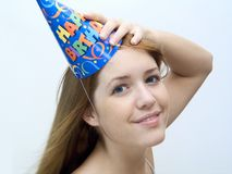 Its my party.. Woman wearing a birthday hat, smiling Royalty Free Stock Image
