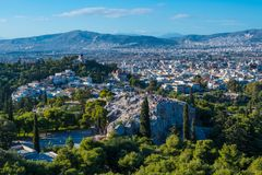 Panoramic view of Athens and Aeropagus, a prominent rock outcropping located northwest of the Acropolis in Athens, Greece. stock photo