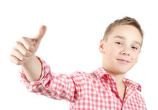 Its OK. Teenager showing thumbs up, white background Royalty Free Stock Photos