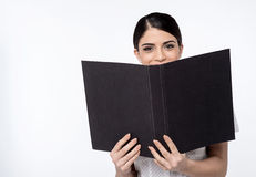 Its our annual report. Image of a young female executive with open folder Stock Photography