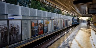 Its paterson skytrain station burnaby Canada. Skytrain coming station beautiful sunset cover whole platform in summer time stock image