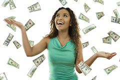 Its raining money. Stock image of woman standing with open arms amidst falling money Stock Photography