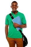 Its study time. Young african student. Carrying laptop bag and notebook Stock Image