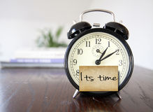 Its time. Alarm clock with note its time stock images