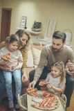 Its time for pizza. Family at home stock photo