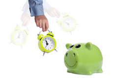 Its time for savings. Alarm clock and piggy bank as concept  for savings Stock Photo