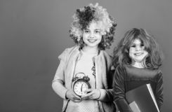 Its time to celebrate. Little girls wearing crazy wigs going to party night. Cute children with fancy hair waiting for royalty free stock photography