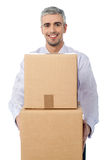 Its time to move to a new office. Middle aged corporate man holding stack of boxes Royalty Free Stock Photography