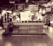 Itsfingerlickin& x27 de la cocina de Desi Kfc Indian; bueno Imágenes de archivo libres de regalías
