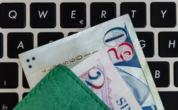 Singapore Dollars on a  keyboard royalty free stock images