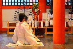 Itsukushima Shinto Shrine, Miyajima, Japan. Shinto priests in Itsukushima Shinto Shrine, Miyajima, Japan royalty free stock image