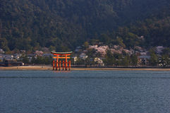 Itsukushima Shrine with Torii At Cherry Blossom Stock Photos