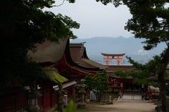 Itsukushima torii and buildings Stock Photos