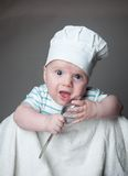 Ittle boy in a chef hat Royalty Free Stock Photography