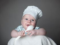 Ittle boy in a chef hat Stock Image